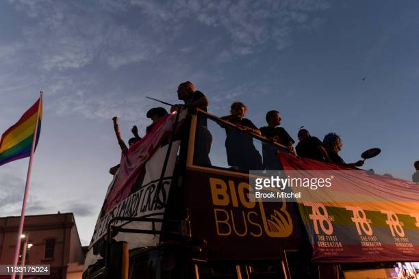 Participants ride a bus along Oxford Street during the 2019 Sydney Gay Lesbian Mardi Gras Parade on March 02 2019 in Sydney Australia The Sydney...