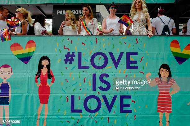 Participants ride in a 'Love is Love' float during Berlin's annual Christopher Street Day gay pride parade on July 22 2017 Gays and lesbians all...