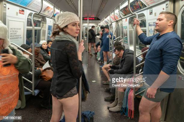 Participants ride the F subway line during the 18th annual No Pants Subway Ride on January 13 2019 in New York City 24 cities participate in the...