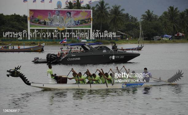 Participants row their boat back to the start line during a dragon boat race on the Narathiwat river in Thailand' southern Narathiwat province on...