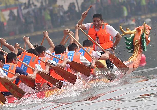 Participants row their boat during a dragon boat race on June 9 2016 in Zhengzhou Henan Province of China About 1500 people on 69 teams participated...