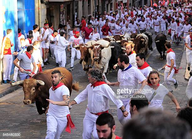 Participants run ahead Cebada Gago fighting bulls on the second day of the San Fermin bull run in Pamplona northern Spain on July 8 2016 On each day...
