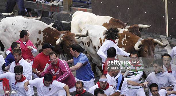 Participants run ahead of Cebada Gago fighting bulls on the second day of the San Fermin festival on July 8 in Pamplona northern Spain On each day of...