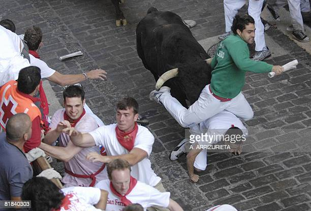 Participants run ahead of Conde de la Corte fighting bulls on the first day of the San Fermin bull run on July 7 in Pamplona northern Spain Spain's...