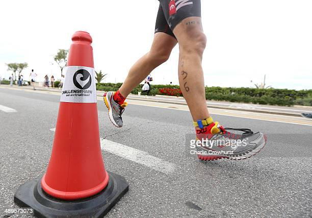 Participants run along the sea front during the run leg during the Challenge Triathlon Rimini on May 11 2014 in Rimini Italy