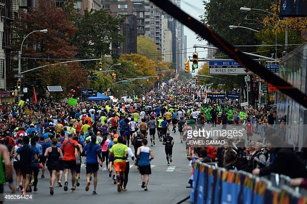 Participants run down the 1st Avenue during the TCS New York City Marathon in New York on November 1 2015 AFP PHOTO/JEWEL SAMAD