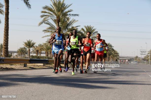 Participants run during 21kilometers long halfmarathon within Baghdad's international 'Love and Peace' Marathon on February 04 2017 in Baghdad Iraq