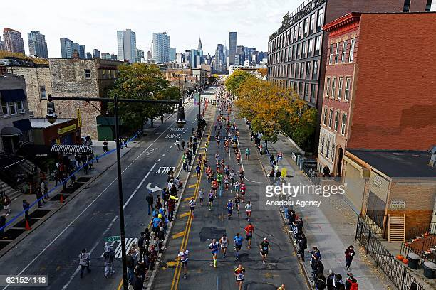 Participants run during the 2016 New York City Marathon which starts from Staten Island continues through Brooklyn Queens Bronx regions and finishes...