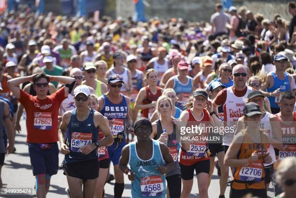 Participants run during the 2018 London Marathon in central London on April 22 2018