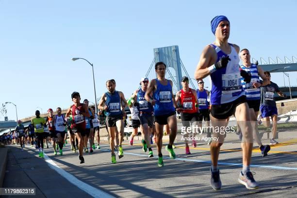 Participants run during the New York City Marathon in Manhattan, New York, United States on November 03, 2019.