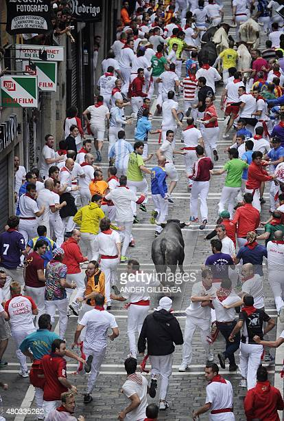 Participants run in front of Jose Escolar Gil's bulls during the fifth 'encierro' of the San Fermin Festival in Pamplona northern Spain on July 11...
