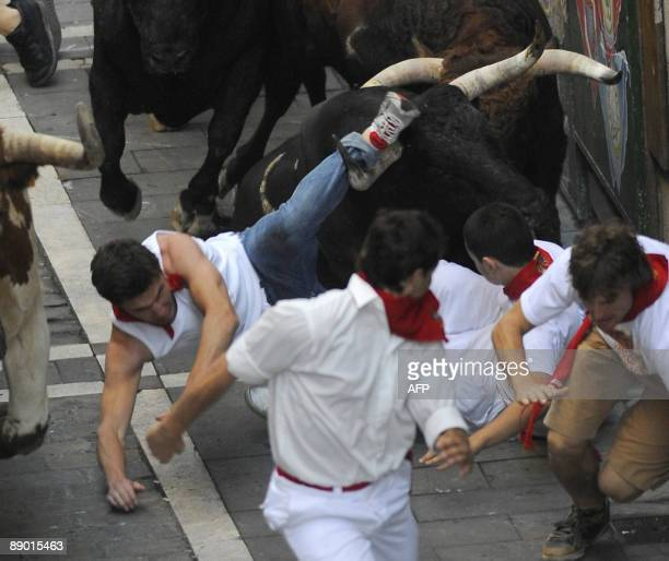 Participants run in front of Nuñez del Cuvillo fighting bulls on the last San Fermin Festival bull run on July 14 in Pamplona northern Spain The...