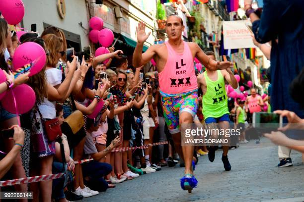 Participants run in the High Heels Race as part of the Gay Pride 2018 celebrations in Madrid on July 5 2018