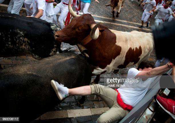 Participants run next to Puerto de San Lorenzo's fighting bulls on the first day of the San Fermin bull run festival in Pamplona northern Spain on...