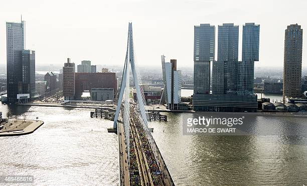 Participants run on the Erasmusbrug during the Rotterdam Marathon in Rotterdam on April 12 2015 AFP PHOTO / ANP / MARCO DE SWART netherlands out