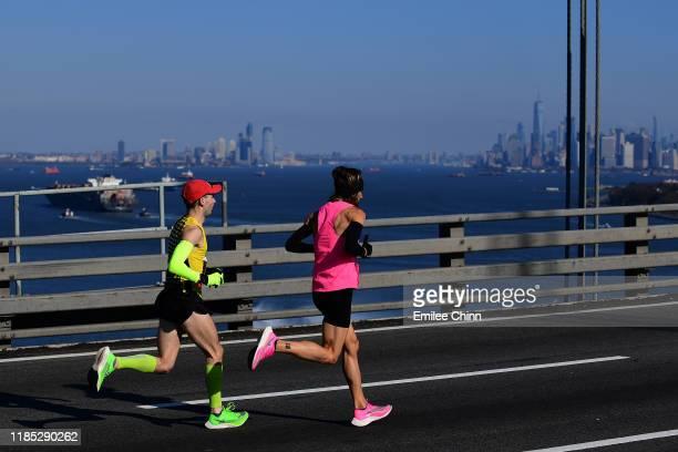 Participants run over the Verrazzano Bridge at the start of the TCS New York City Marathon on November 03, 2019 in the Staten Island borough of New...