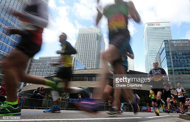 Participants run through Canary Wharf during the 2016 Virgin Money London Marathon on April 24 2016 in London England