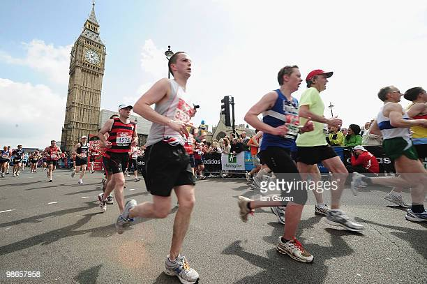 Participants run through Parliament Square in Westminster during the 2010 Virgin London Marathon on April 25 2010 in London England
