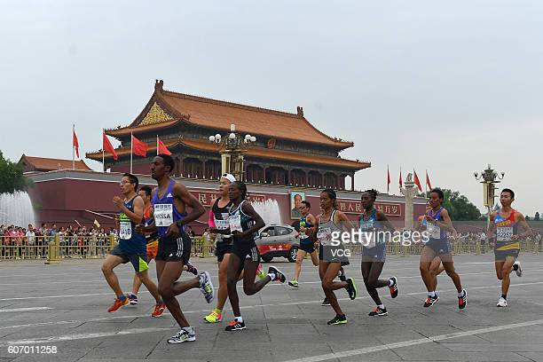 Participants run through the Tian'anmen rostrum during the 2016 Beijing Marathon on September 17 2016 in Beijing China Running from the Tian'anmen...