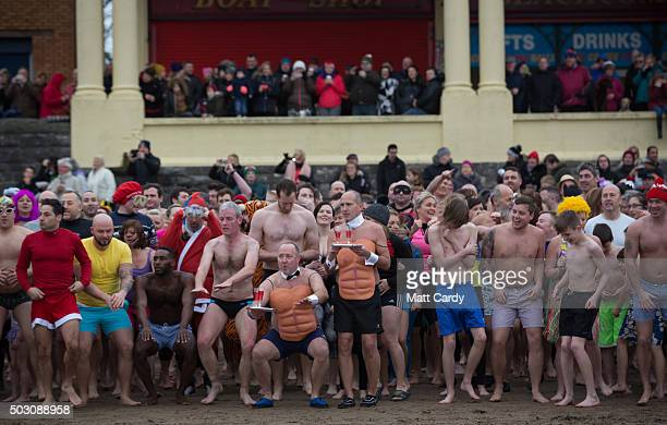 Participants run towards the sea as they take part in the annual New Year's Day swim at Barry Island as several hundred swimmers marked start of 2016...