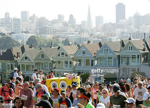 Participants run up Hayes Street Hill with the backdrop of the city's Painted Ladies houses during the ING Bay to Breakers race May 17 2009 in San...