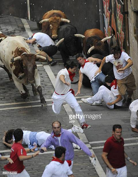 Participants run with Nuñez del Cuvillo fighting bulls on the last San Fermin Festival bull run on July 14 in Pamplona northern Spain The festival is...