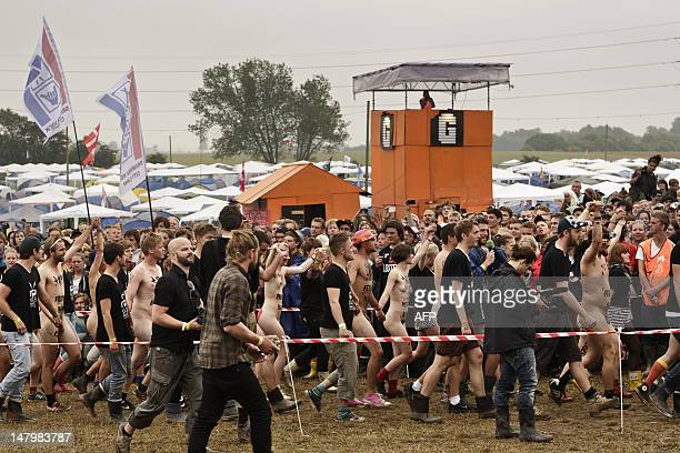 Participants running in the annual Naked Run in the camp site at the Roskilde Festival west of Copenhagen on on July 7 2012 AFP PHOTO/Andreas...