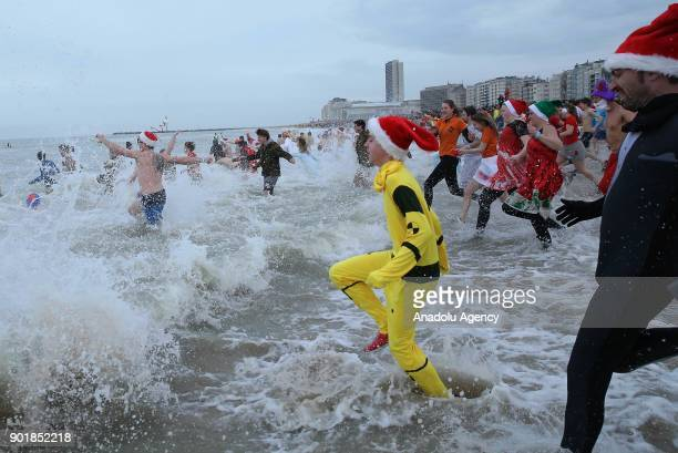 Participants rush in the water during a polar bear plunge on a cold day in Oostende Belgium on January 06 2018 Approximately 5000 participants some...
