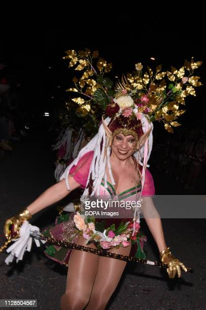 A participants seen dressed up in a colour full costume performing during the carnival According to tradition people dress up in different color full...