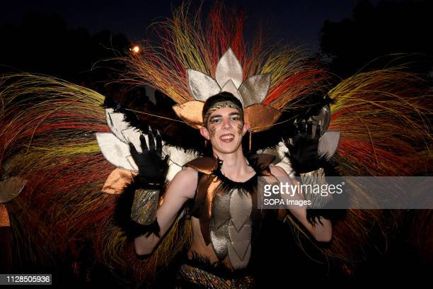 A participants seen dressed up in a colourful costume performing during the carnival According to tradition people dress up in different color full...