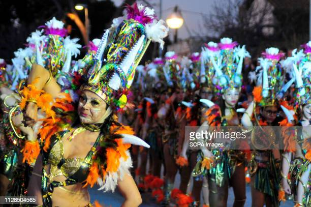 Participants seen dressed up in colourful costumes performing during the carnival According to tradition people dress up in different colorful...