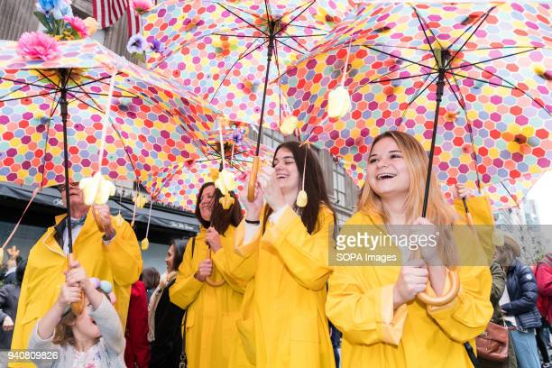 Participants seen holding colourful umbrellas during the parade. The Easter Bonnet parade hosted on Fifth Avenue in midtown Manhattan.