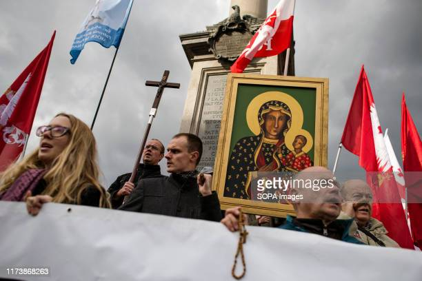 Participants seen holding Polish flags rosaries a painting of Virgin Mary and a crucifix during the National Rosary March The National Rosary March...