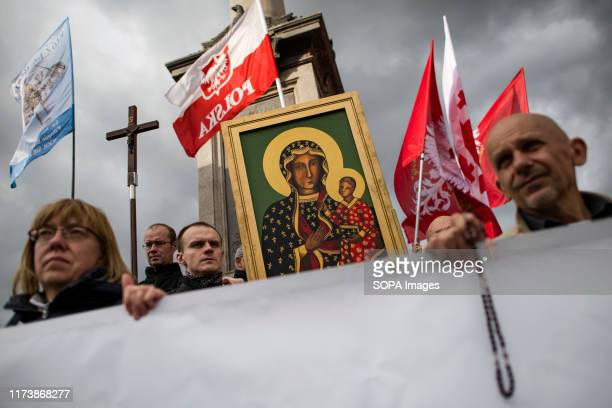 Participants seen holding Polish flags rosaries a painting of Virgin Mary and a crucifix during the National Rosary March in Warsaw The National...