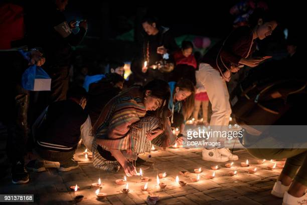 Participants seen lighting up candles during the event The international women's day is being celebrated in Kathmandu with hundreds of women taking...