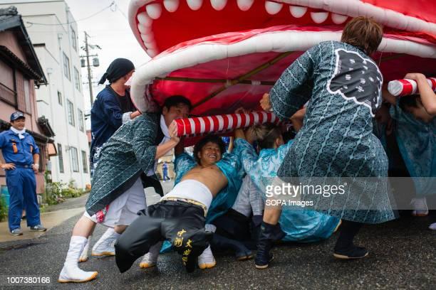 Participants seen moving a sea bream figure during the festival The sea bream or tai maturi festival is a traditional festival in Minamichita Aichi...