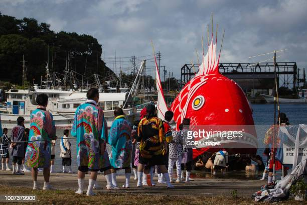 Participants seen moving a sea bream figure through water during the festival The sea bream or tai maturi festival is a traditional festival in...