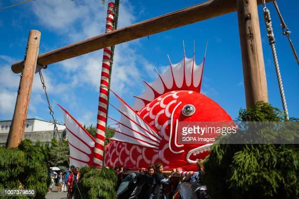 Participants seen moving the sea bream figure through town The sea bream or tai maturi festival is a traditional festival in Minamichita Aichi Japan...