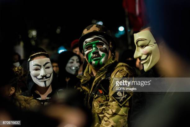 Participants seen wearing the Guy Fawkes mask during the march Demonstrators attend the Annual Million Mask March bonfire night protest advertised as...