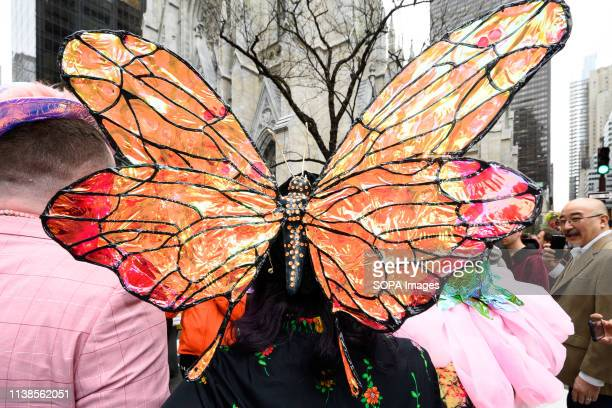 Participants seen with a butterfly costumes during the Easter Bonnet parade on Fifth Avenue in midtown Manhattan in New York City.