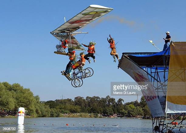 Participants send their 'aircraft' off the edge of a pier during Flugtag the 'Red Bull' flying day competition on October 17 2003 in Tel Aviv Israel...