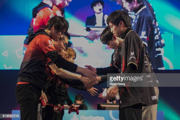 Participants shake hands after they finish playing Activision Blizzard Inc's Call of Duty game during the Tokaigi Game Party Japan esports...