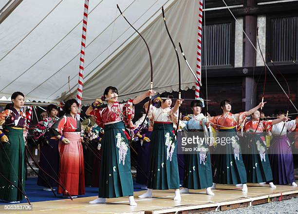 Participants shoot arrows wearing 'Furisode' a long sleeved kimono take part in an archery event for 20yearolds to celebrate their comingofage at...