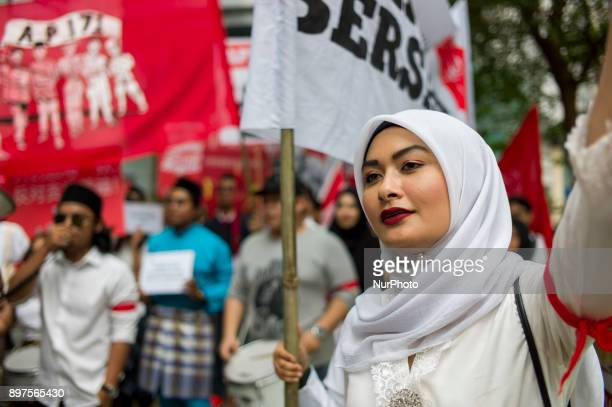 Participants shout slogans as they take part in a march to commemorate the 71st anniversary of the formation of Angkatan Pemuda Insaf in Kuala Lumpur...
