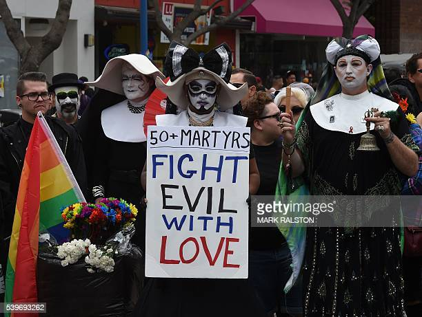 Participants show their support for victims of the Orlando shooting during the 2016 Gay Pride Parade on June 12, 20116 in Los Angeles, California....