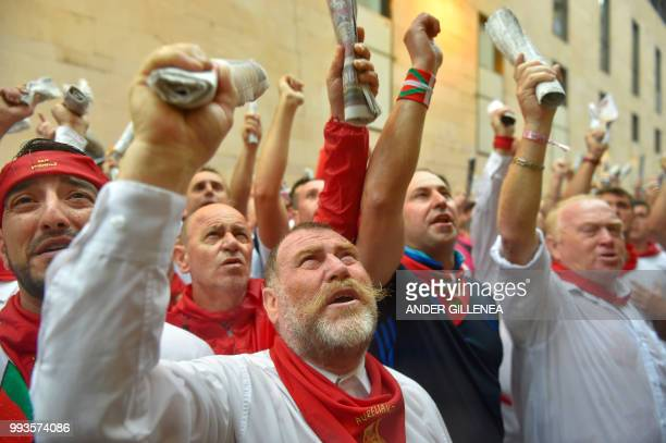 Participants sing before running next to Jose Escolar fighting bulls on the second day of the San Fermin bull run festival in Pamplona northern Spain...