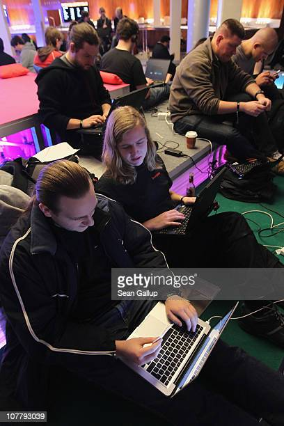 Participants sit at laptop computers as they attend the annual Chaos Communication Congress of the Chaos Computer Club at the Berlin Congress Center...