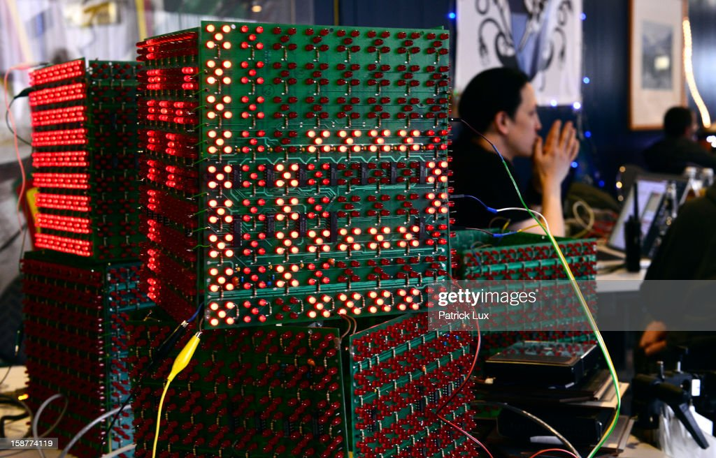 Participants sit behind led display units at the annual Chaos Computer Club (CCC) computer hackers' congress, called 29C3, on December 28, 2012 in Hamburg, Germany. The 29th Chaos Communication Congress (29C3) attracts hundreds of participants worldwide annually to engage in workshops and lectures discussing the role of technology in society and its future.