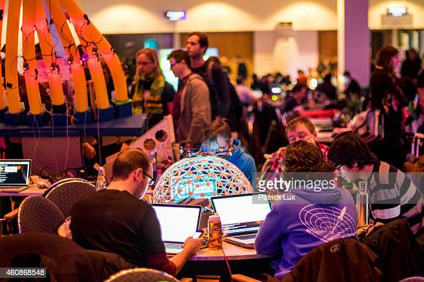 Participants sit with laptop computers at the 31st annual Chaos Communication Congress on December 28 2014 in Hamburg Germany The annual congress is...
