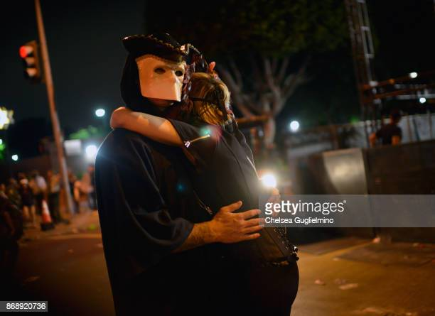 Participants slow dance at the West Hollywood Halloween Carnaval on October 31 2017 in West Hollywood California